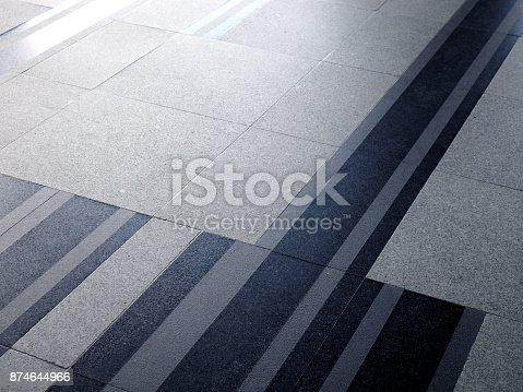White grey pattern marble floor with diagonal black line tile, and white sunlight reflection shade and shadow background