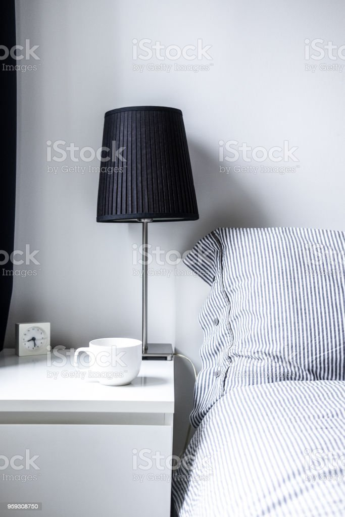 White gray minimalist bedroom design stock photo