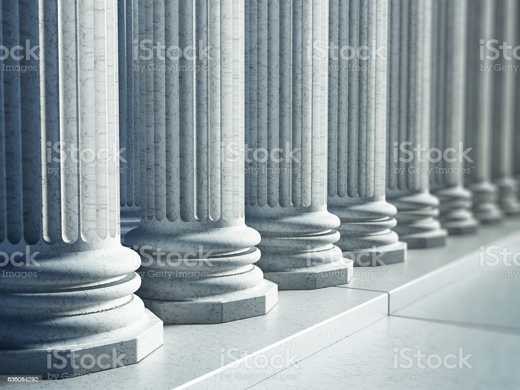 White Greek pillars along the road stock photo