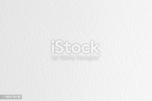 istock White grey color concrete cement wall with detail of rough stucco for background and design art work. 1165476192