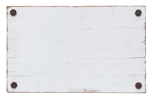 White grunge wood board with four old bolts. Composite image. Isolated on white, clipping path included.