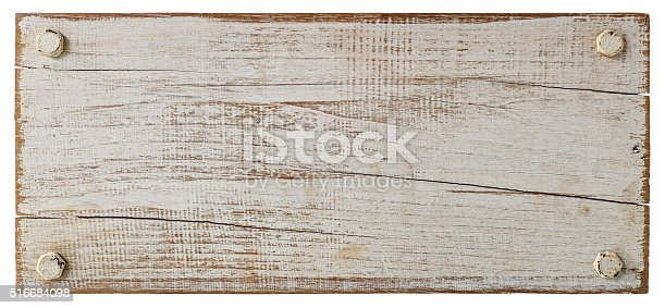 White grunge wood board with four old bolts.