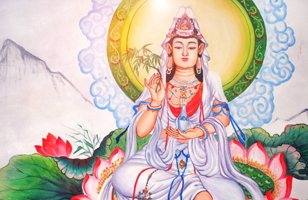 white Guan Yin lady chinese god wall paint at local public chinese temple in Chiangmai Thailand - the Goddess of Mercy and Compassion in the buddhist religion white Guan Yin lady chinese god wall paint at local public chinese temple in Chiangmai Thailand - the Goddess of Mercy and Compassion in the buddhist religion bodhisattva stock pictures, royalty-free photos & images