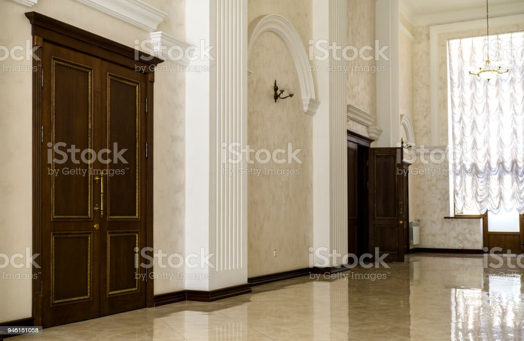 White Hallway With Marble Floor Brown Doors And Window In Hospital Stock Photo Download Image Now Istock