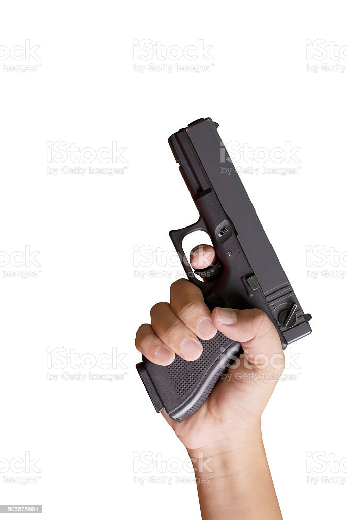 White hand holds gun isolated on white background. stock photo