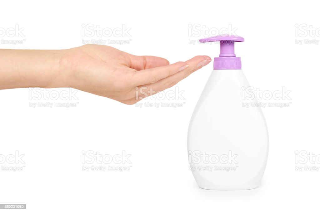 White hand sanitizer soap dispenser in hand isolated on white background. Housework and sanitary concept stock photo