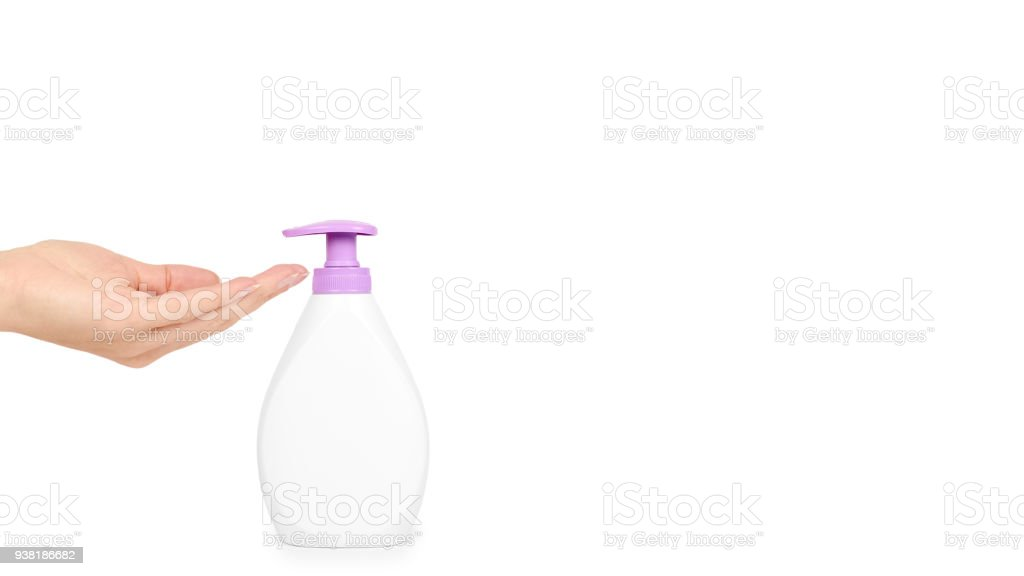 White hand sanitizer soap dispenser in hand isolated on white background. Housework and sanitary concept. copy space, template stock photo