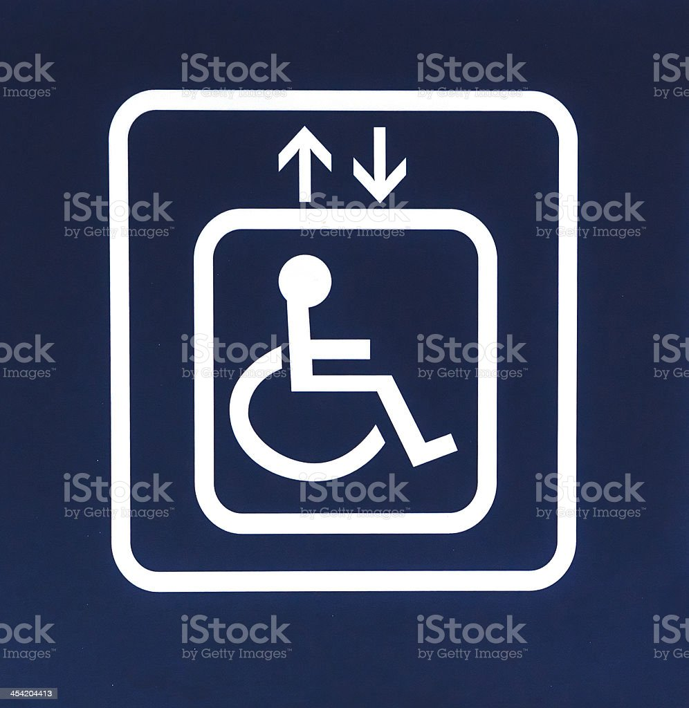 White Handicap Elevator Sign on Blue Background, Closeup stock photo