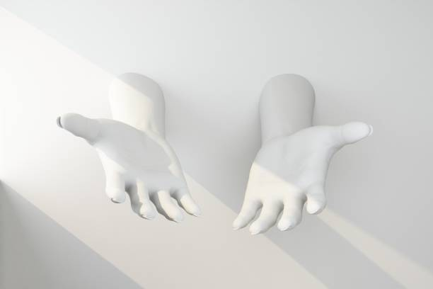 white hands stretched out of the wall stock photo