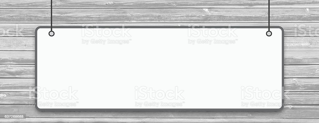 White hanging billboard on horizontal wooden planks. stock photo