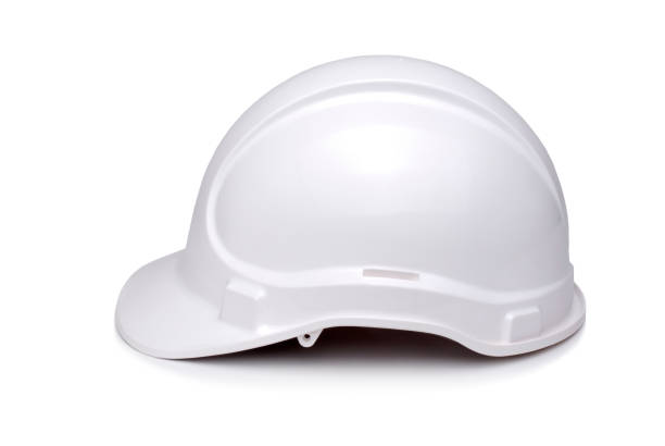 White hard hat viewed from side and isolated on white. stock photo