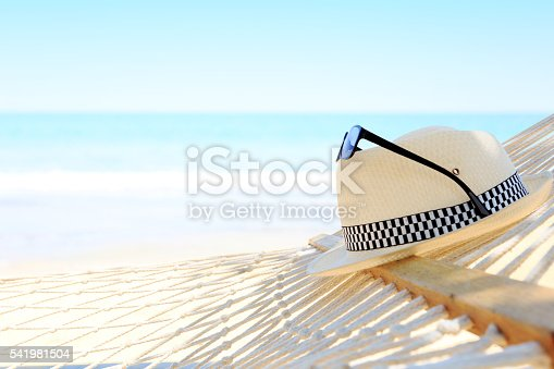 istock White hat and sunglasses with hammock on Beach view summer 541981504