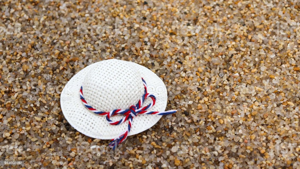A white hat on the sand. stock photo
