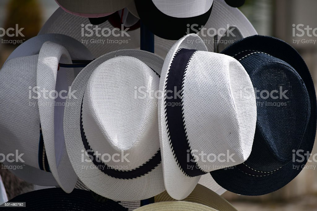 white hats and black one stock photo