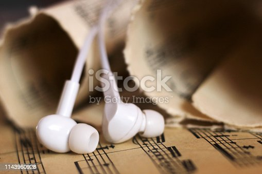 White headphones and paper old notes, retro object