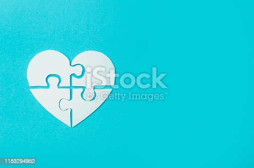 istock White heart made of symbolic autism puzzle pieces 1153294952