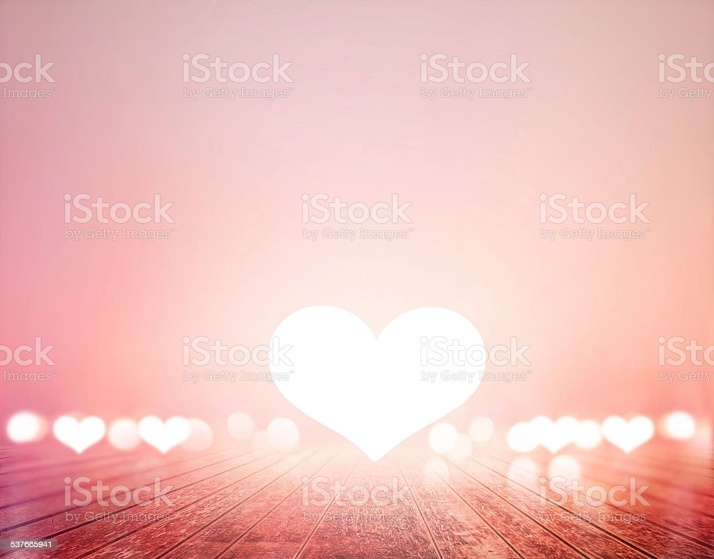 white heart on wooden floor vibrant, soft and blur concept stock photo