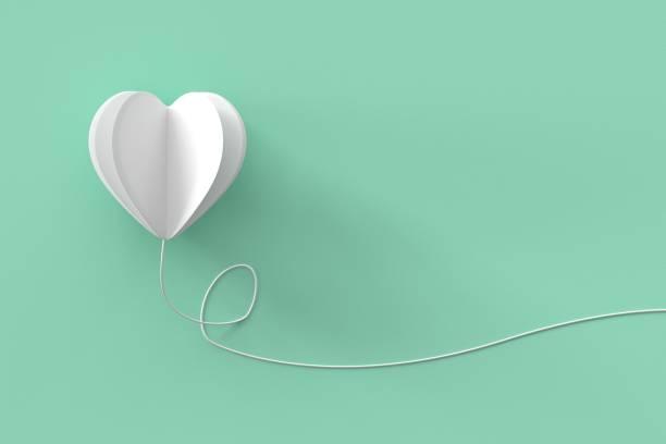 Weiße Herzform mit Linie auf grünem Hintergrund Pastell.  minimale Valentine Konzeptidee. – Foto