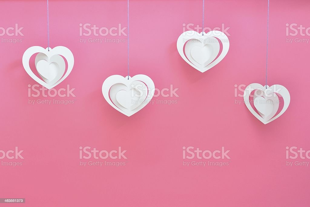 White hearts on pink background stock photo