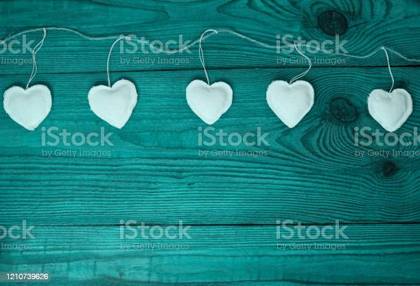 White hearts on turquoise blue duotone color wooden background day picture id1210739626?b=1&k=6&m=1210739626&s=612x612&h=0cort1sw 9v8urhb7lmrzipiuo4sktdvkx4zyr g2li=