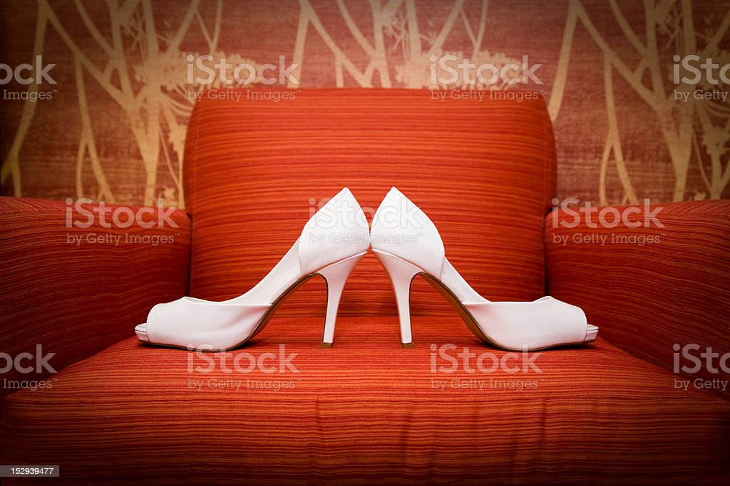 White heels on Red Chair stock photo