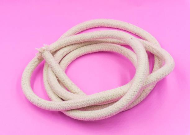 White hemp Rope ready to use on pink pastel background stock photo