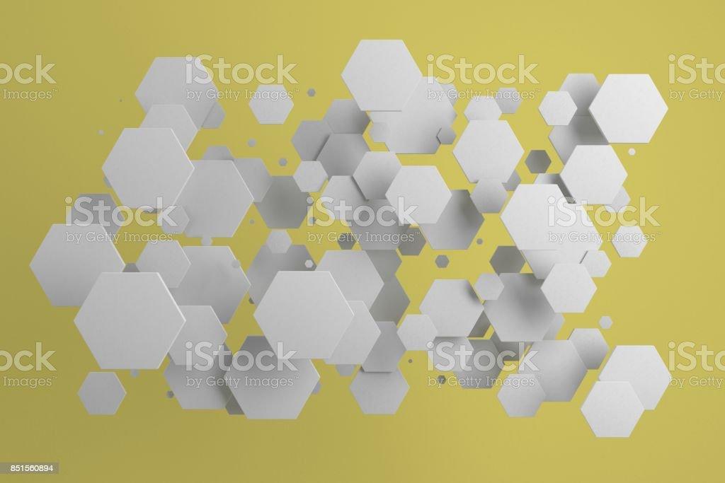 White hexagons of random size on yellow background stock photo
