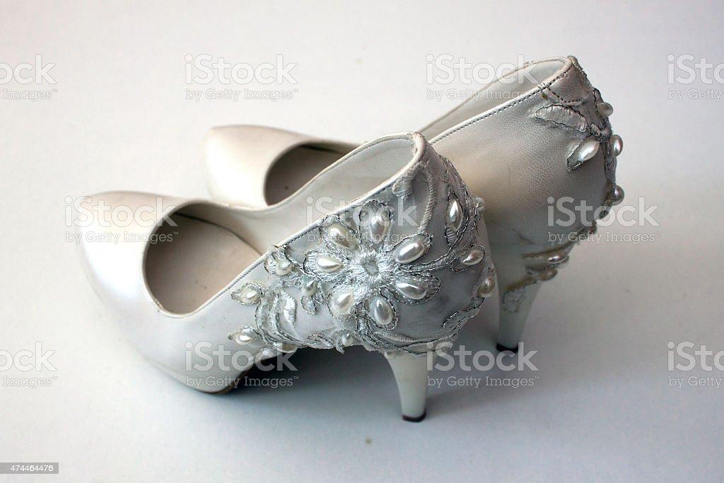 White high-heeled shoes on white background stock photo