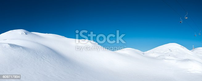 Panoramic view of hills covered with fresh snow (Vogel, Alps, Slovenia).