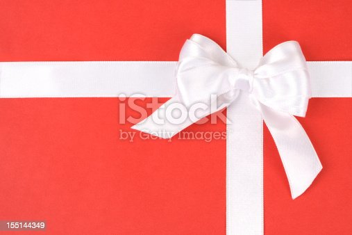 White holiday bow  on red gift