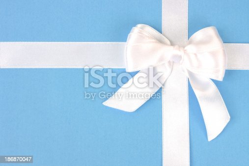 White holiday bow isolated on blue
