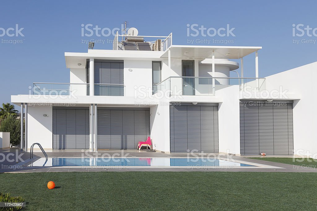 white holiday bungalow with swimming pool Cyprus royalty-free stock photo