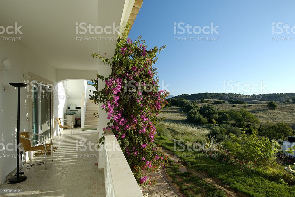 White holiday villa balcony and view at surrounding landscape royalty-free stock photo