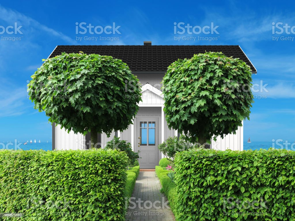 white holidy home with frontyard and view to the sea stock photo
