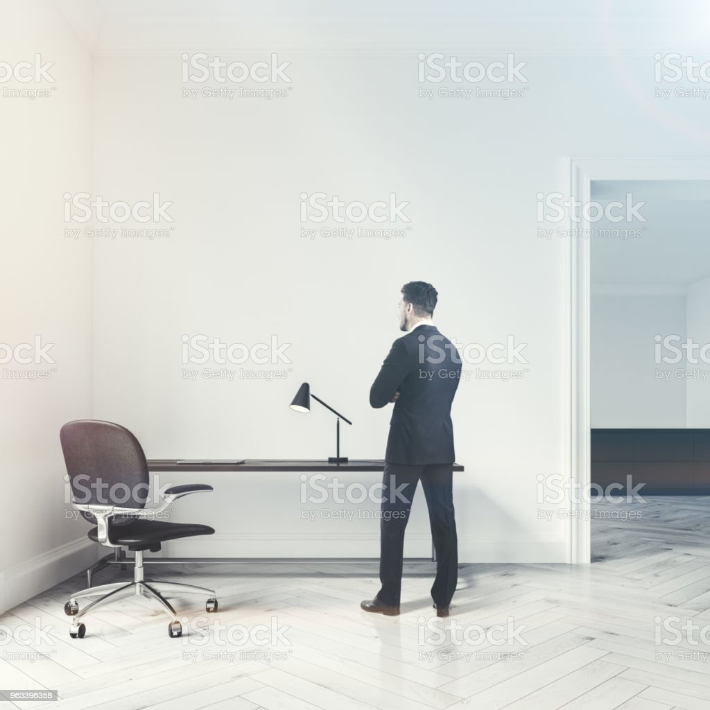 White home office interior, door, man - Zbiór zdjęć royalty-free (Biurko)