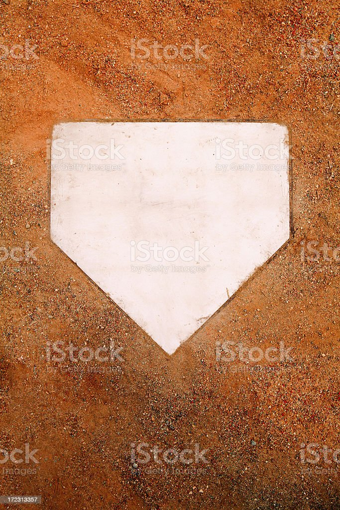 White home plate set in orange sand stock photo