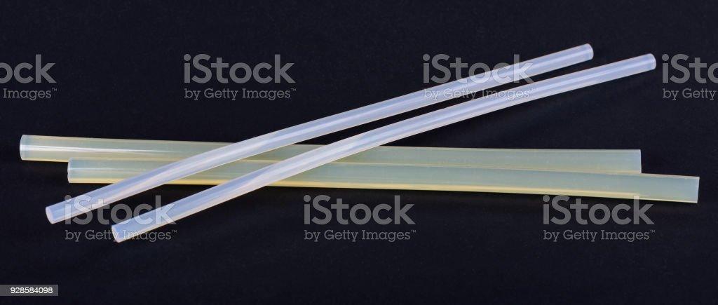 White hot glue sticks for handmade, isolated on black background. DIY. stock photo
