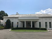 Washington DC USA,Aug 01 2019:Oval office cleaning outer wall.A cleaning worker wearing yellow clothes is manually cleaning.