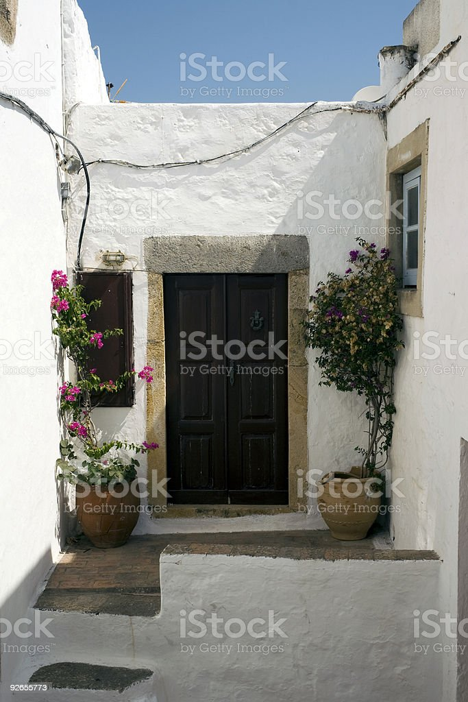 white house entrance in Patmos Island - Greece royalty-free stock photo