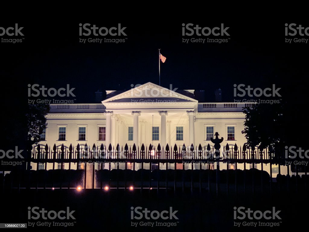White house illuminated at night in Washington D.C. stock photo