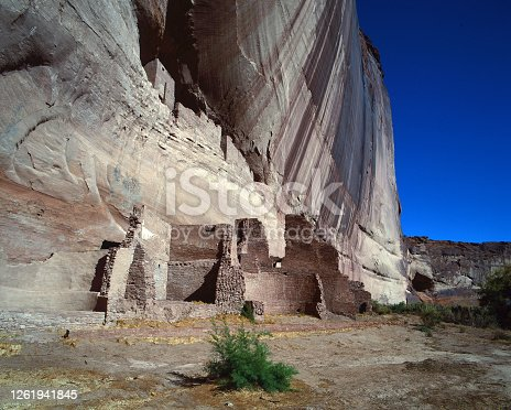 The famous cliff dwelling, White House the lower level, with the stark blue sky contrasting the vanish stained cliff