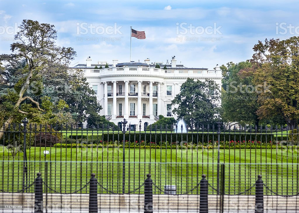 White House South Facade with Flag Catching a Breeze stock photo