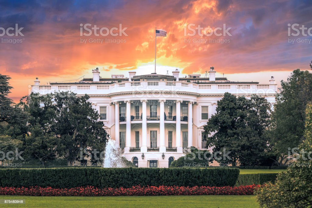 White House, under dramatic sky, sunset golden light, Washington DC stock photo