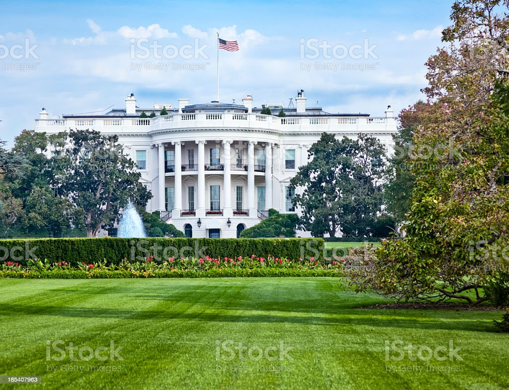 White House with Fountain, Flowers and Lush Green Lawn stock photo
