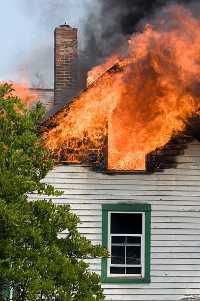 white house with green trim attic is on fire - brand sotiga fönster bildbanksfoton och bilder