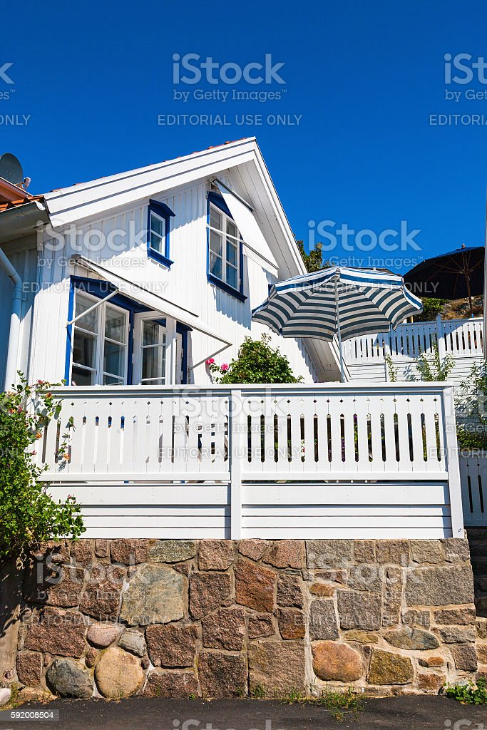 White house with sunny terrace stock photo
