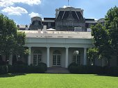 The garden in front of the Oval office where the president makes a news conference on a sunny day.