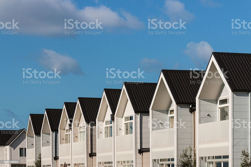 white houses against blue sky stock photo