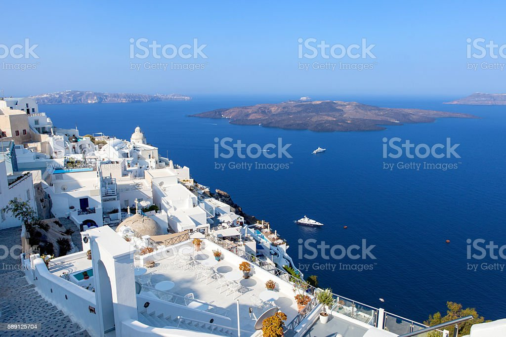 White houses and blue domes of Fira, Santorini. stock photo