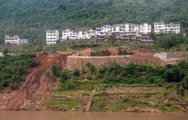 White housing on top of hill with landslide along Yangtze River, China. stock photo